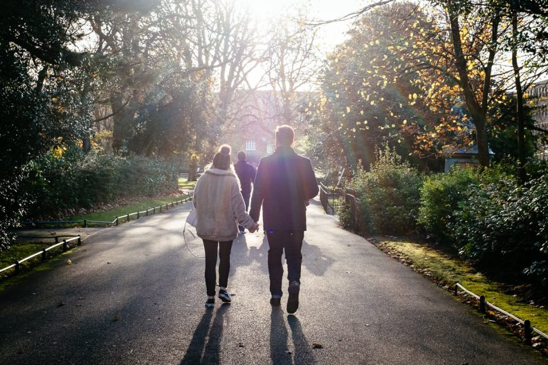 a couple walking hand in hand in st stephens green dublin
