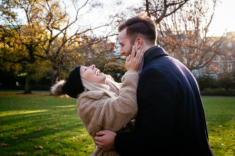 couple laughing in st stephens green dublin after proposing