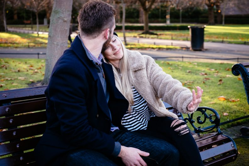 engaged couple admiring her ring in st stephens green dublin