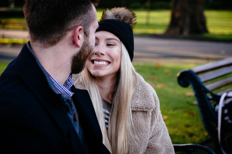 engaged couple embracing in st stephens green dublin
