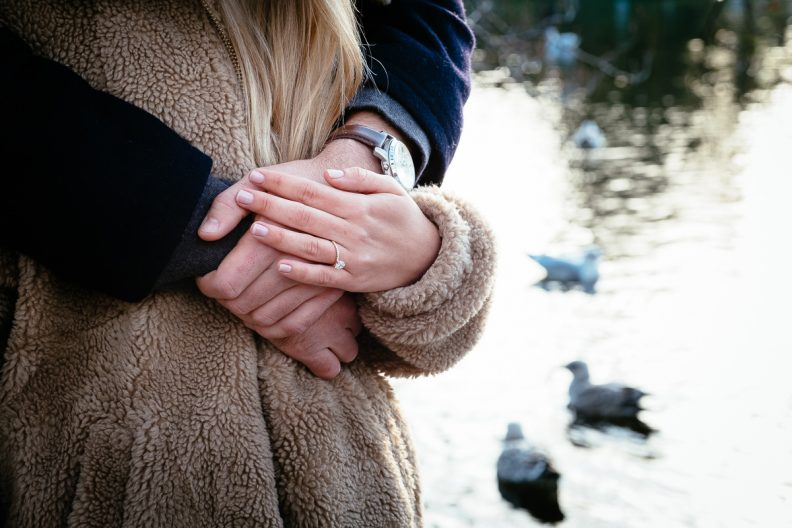 engaged couple by the pond in st stephens green dublin after their proposal