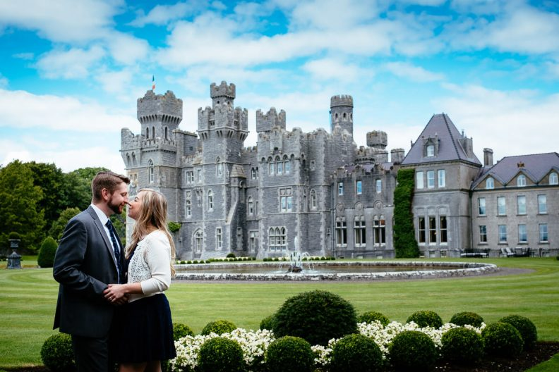engaged couple kissing in ashford castle