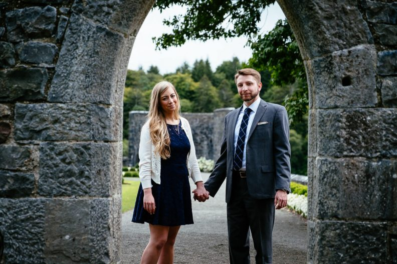engaged couple holding hands n ashford castle