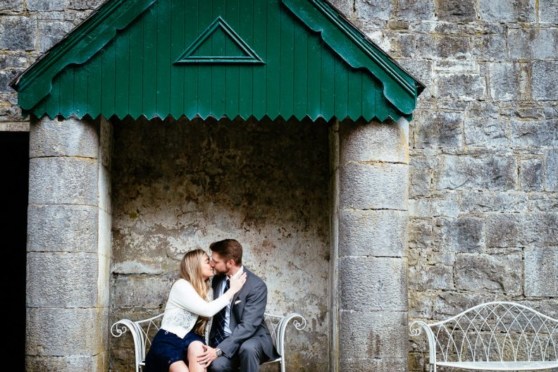 engaged couple kissing in grounds of ashford castle
