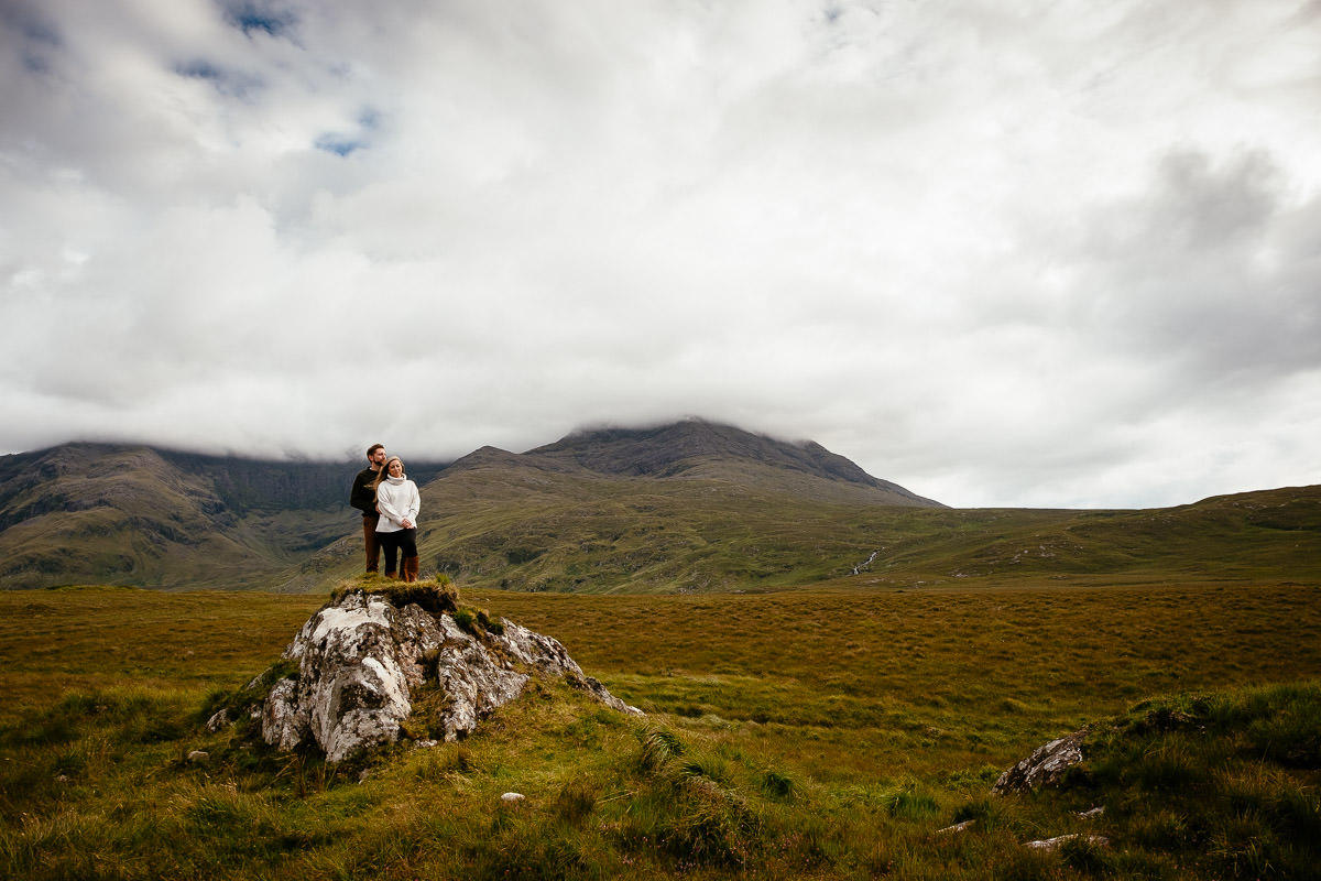 engaged couple on a mountain in wild atlantic way ireland