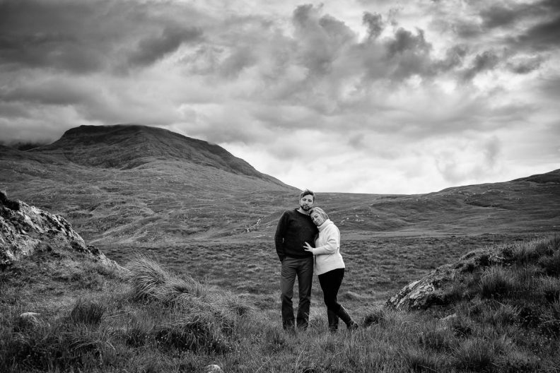 engaged couple on a mountain in wild atlantic way ireland