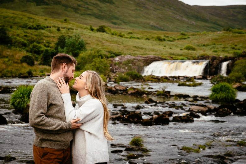 engaged couple in wild atlantic way ireland