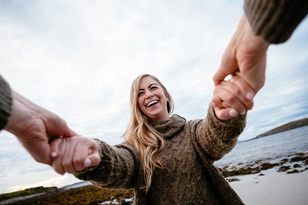 engaged couple on a beach Wild Atlantic Way Engagement Shoot ireland