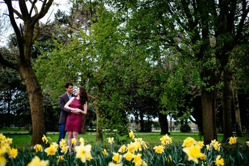 engaged couple with daffodils in dublin park