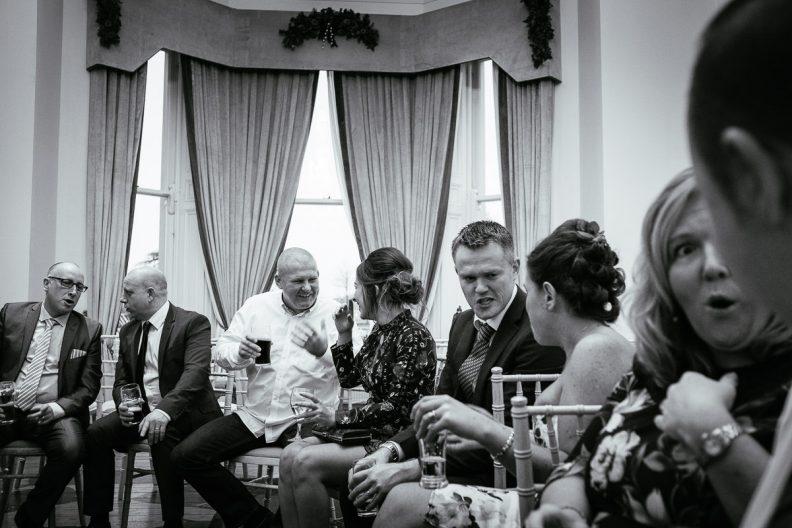 wedding guests talking