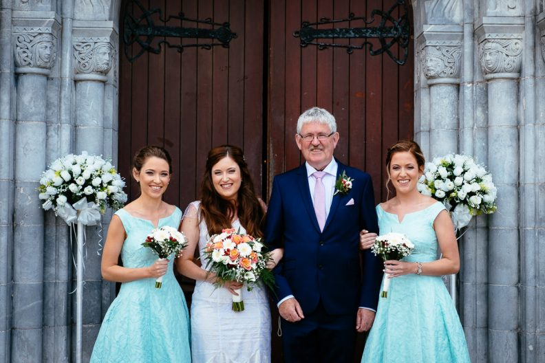 bride at door of honan chapel ucc wedding