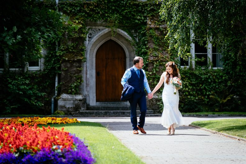 bride and groom strolling at university college cork wedding