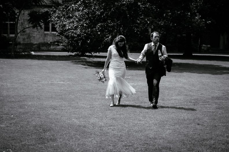 bride and groom walking at university college cork wedding