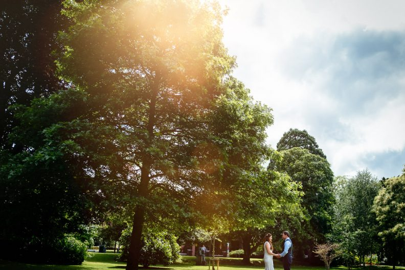 bride and groom with sun flare at university college cork wedding