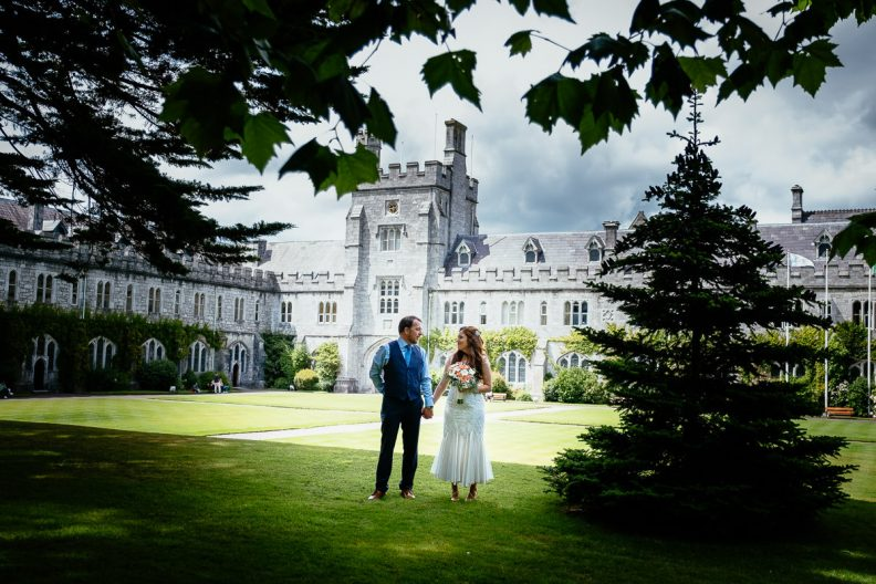 bride and groom in lawn at university college cork wedding