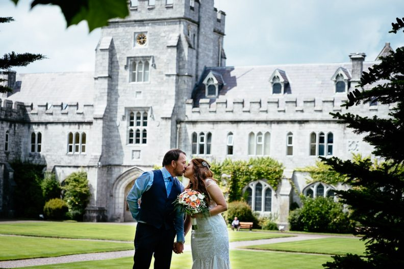 bride and groom kissing at university college cork wedding