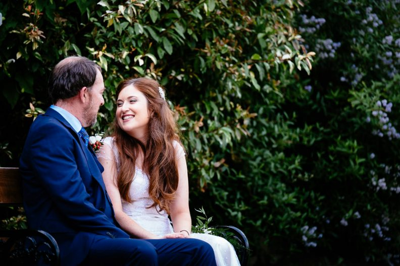 bride and groom sitting at university college cork wedding