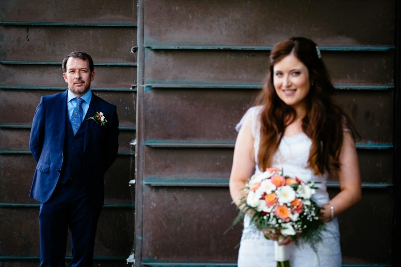 bride and groom standing at university college cork wedding