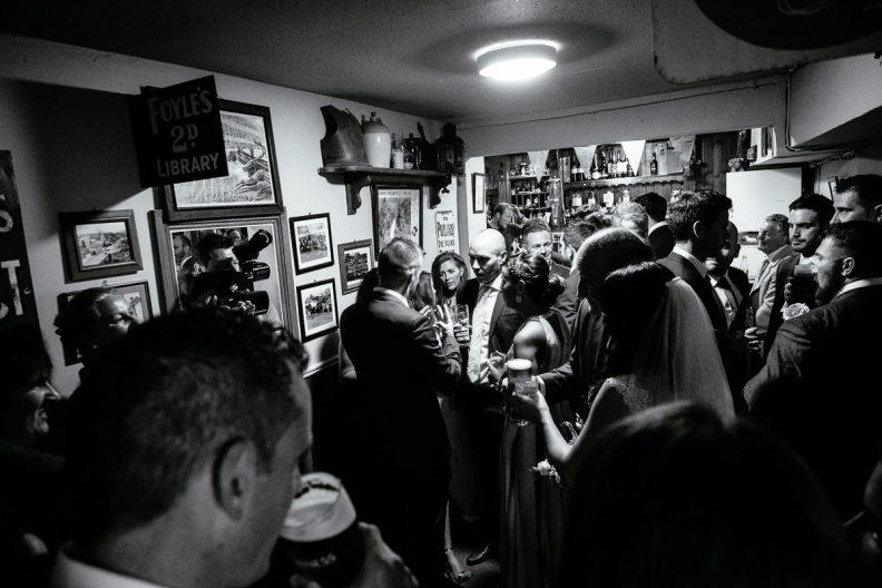 wedding guests at irish country pub
