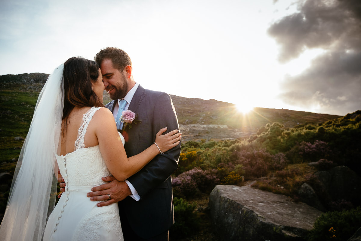 bride and groom at sunset in the wicklow mountains
