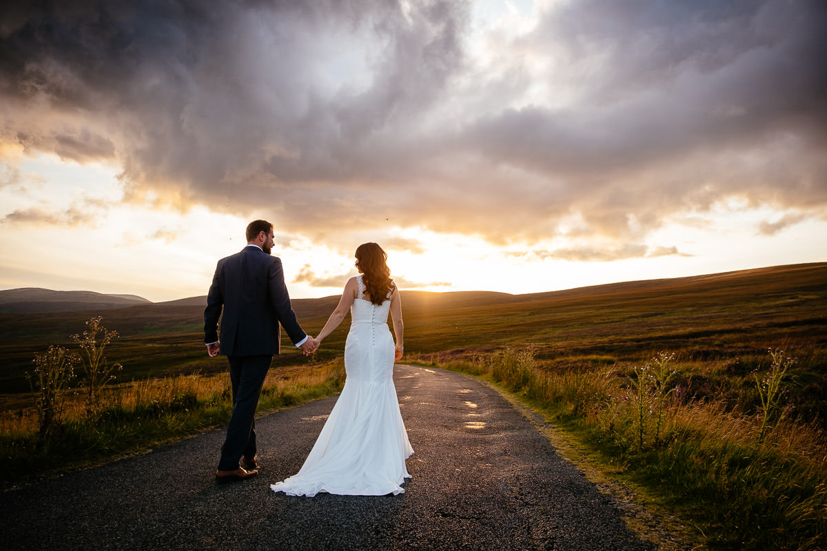 bride and groom at walking in the wicklow mountains