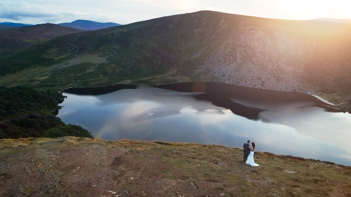 bride and groom at sunset at lough tay