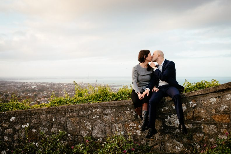 engaged couple overlooking dublin