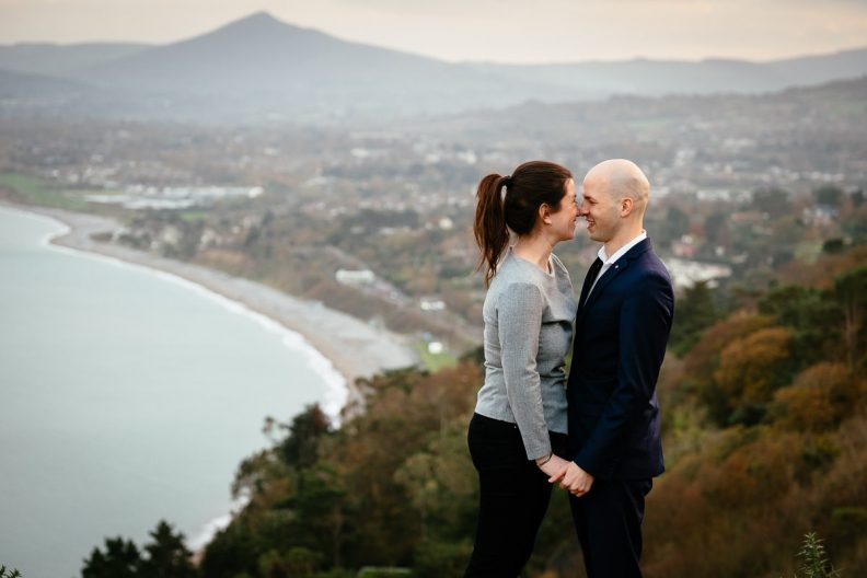engaged couple overlooking dublin bay