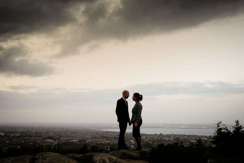 engaged couple with Dublin city in the background