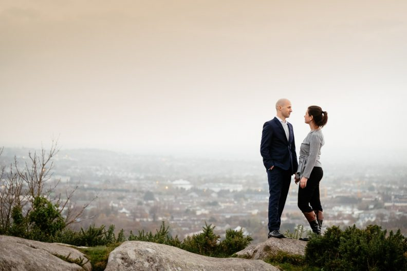 engaged couple with Dublin in the background