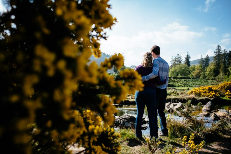 engaged couple at glendalough