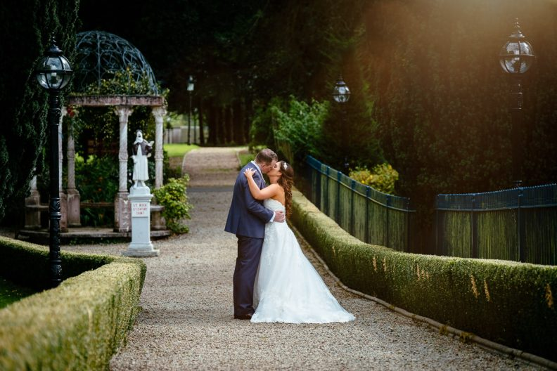 bride and groom embracing at the killashee hotel naas