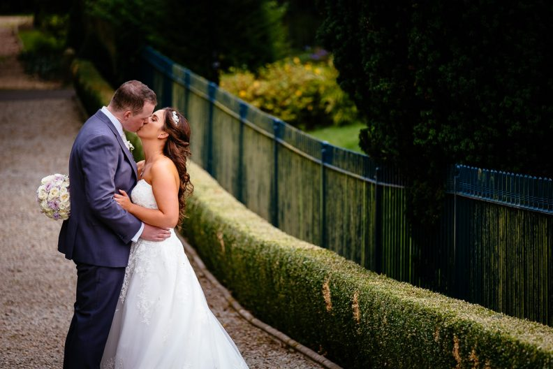 bride and groom kissing at the killashee hotel naas