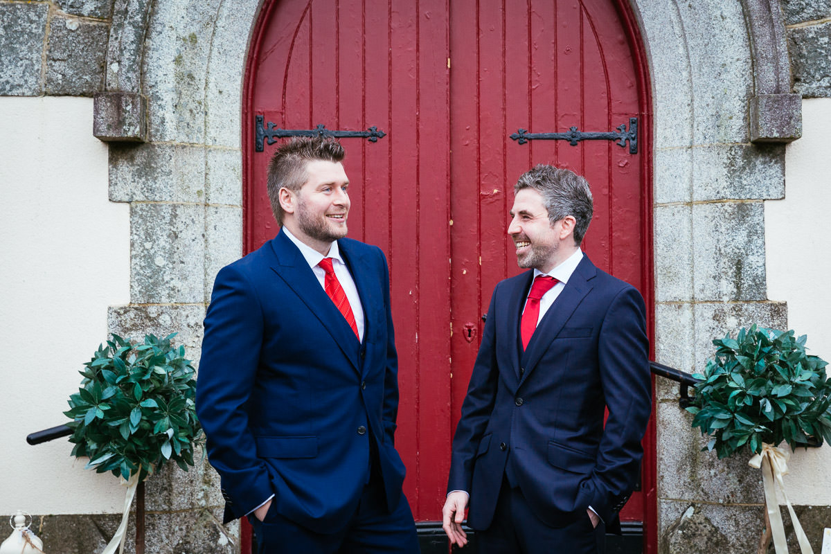 groom and best man outside church