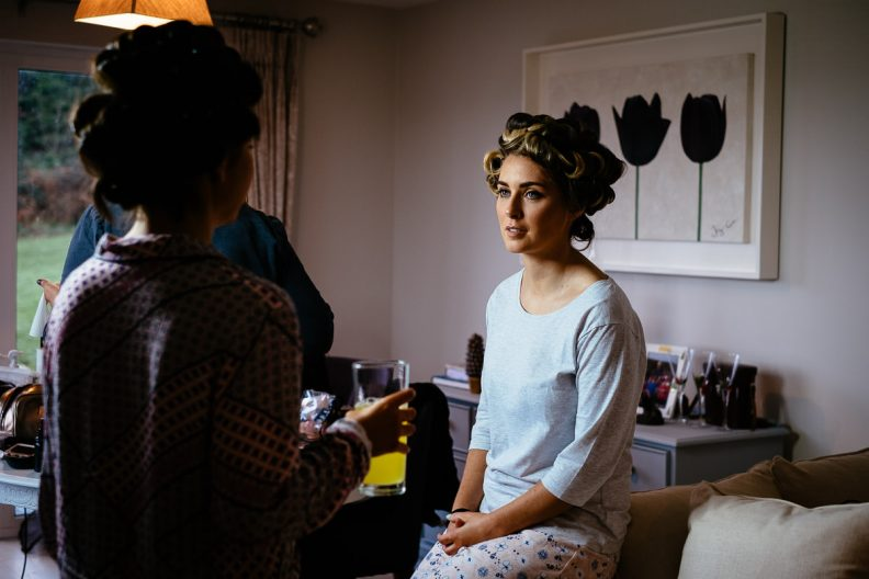 bridesmaid getting makeup