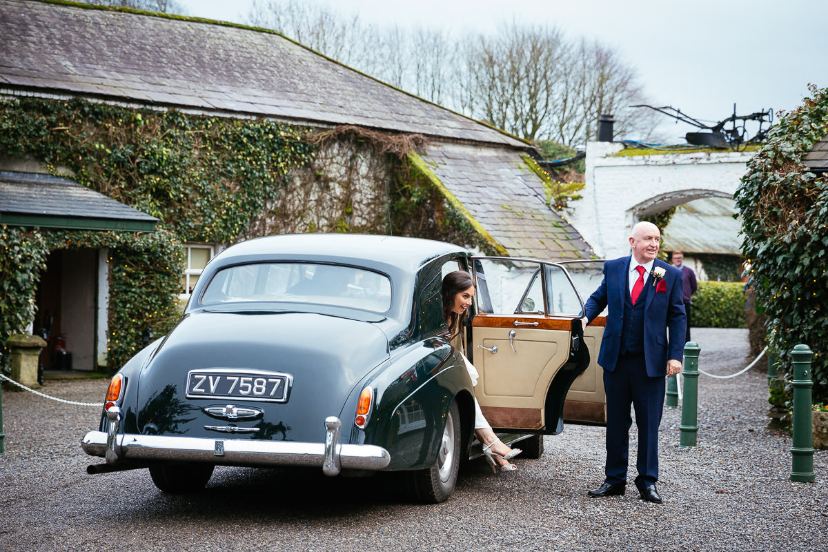 bride and groom in wedding car arriving at rathsallagh house