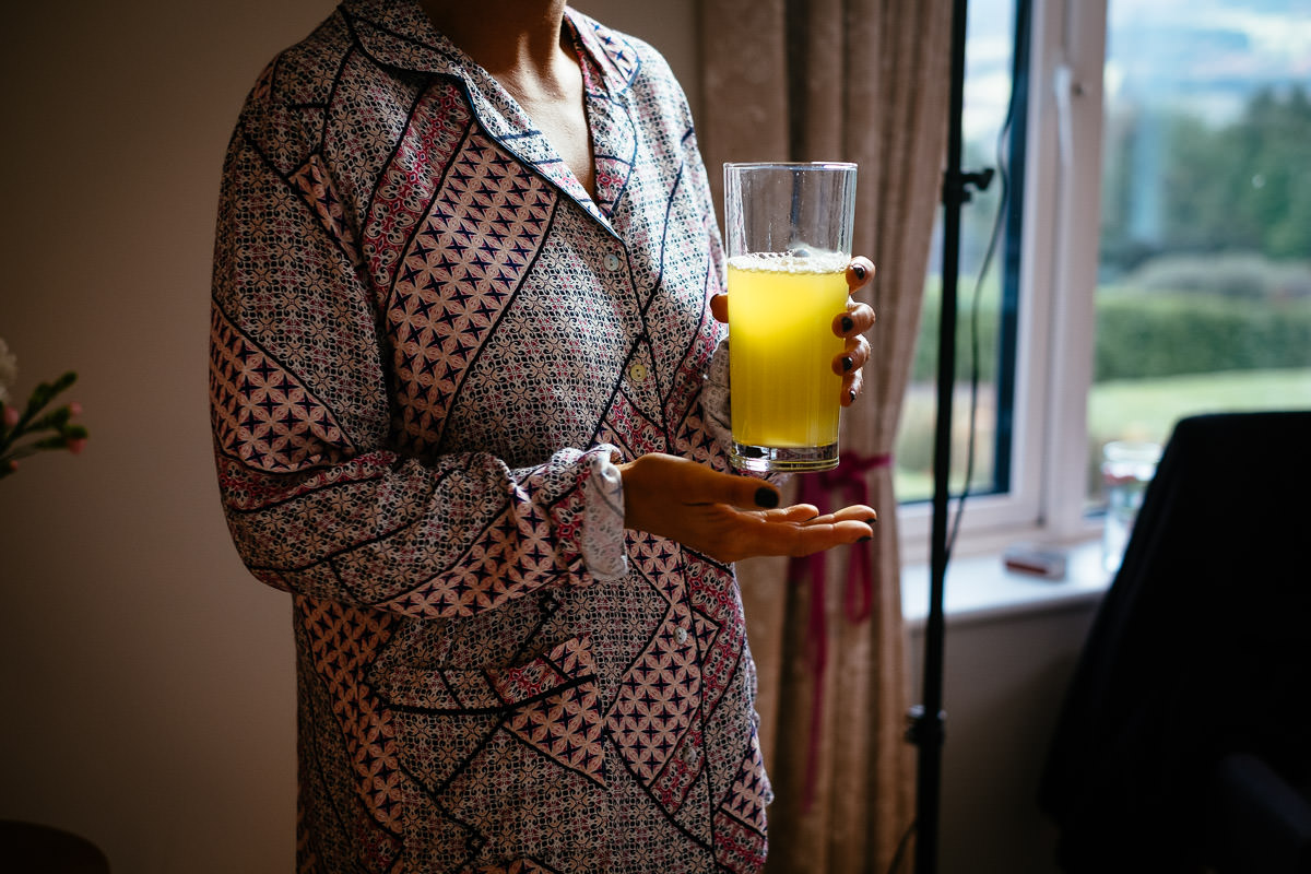 bridesmaid with glass of juice