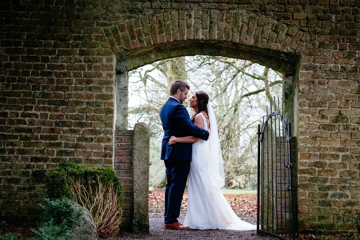 bride and groom at walled garden at rathsallagh house