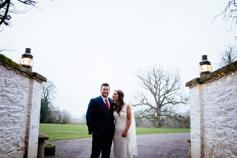 bride and groom in front of rathsallagh house
