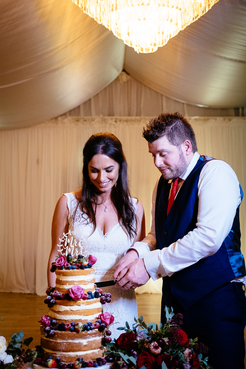 bride and groom cutting wedding cake at rathsallagh house wicklow