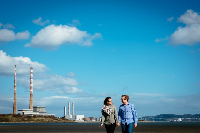 engaged couple on beach at ringsend dublin