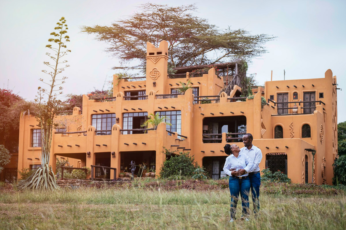 engaged couple embracing in front of the african heritage house nairobi kenya