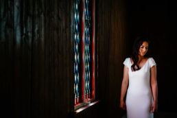 bride at window in st peters tin church laragh monaghan ireland