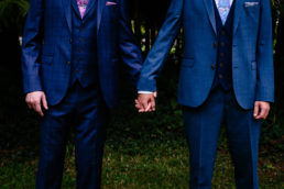 two grooms holding hands at their gay wedding in dublin ireland