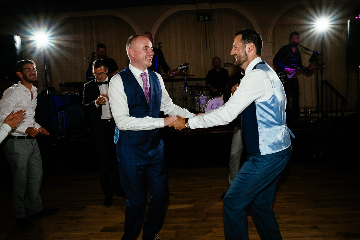 two grooms first dance at their irish gay wedding