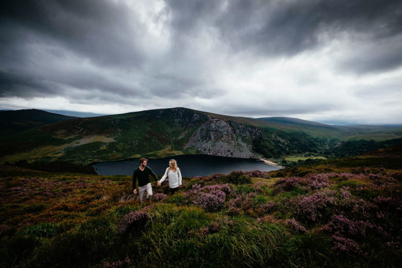 engaged couple walking through heather in rural ireland
