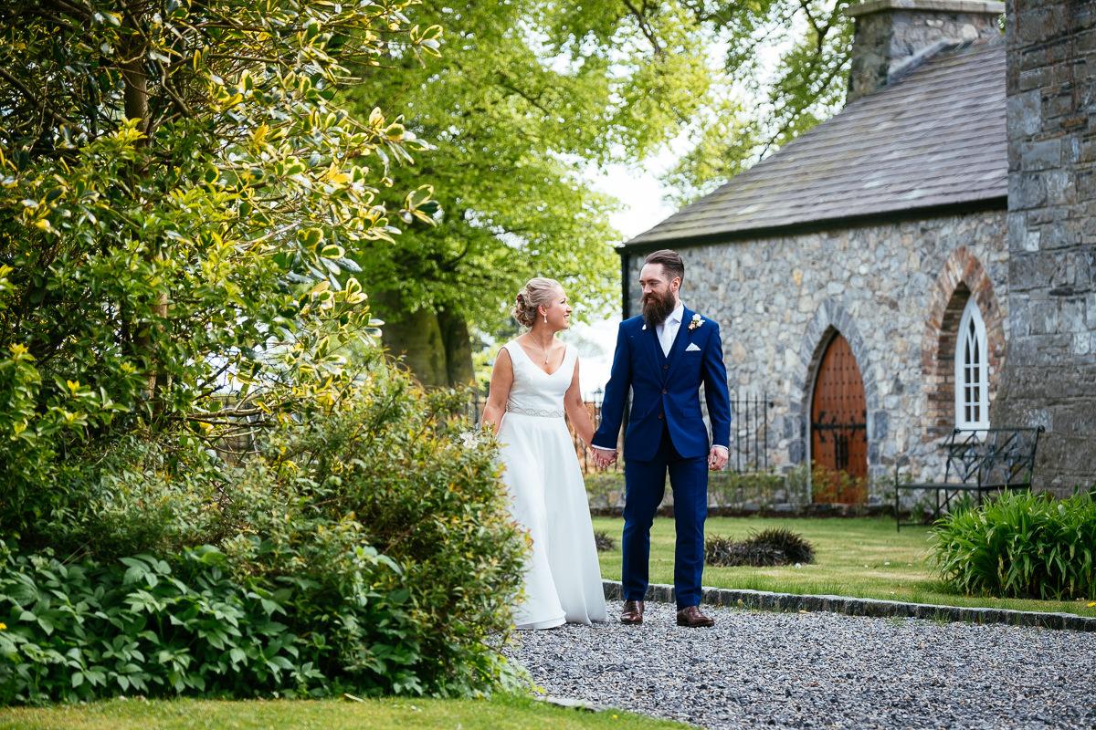bride and groom walking at barberstown castle kildare