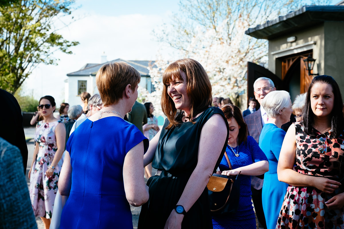 wedding guests laughing at barberstown castle kildare