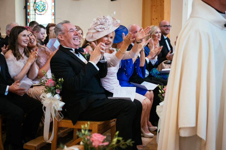 mother of the bride clapping at ceremony