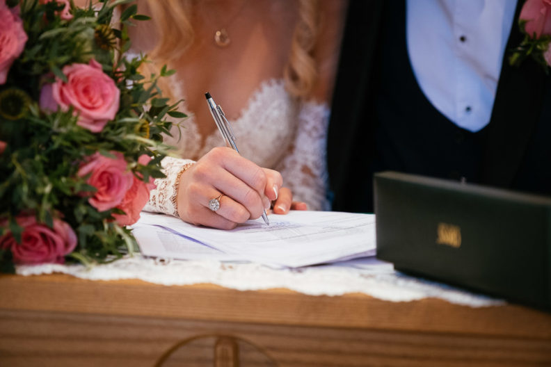 bride signing the registar